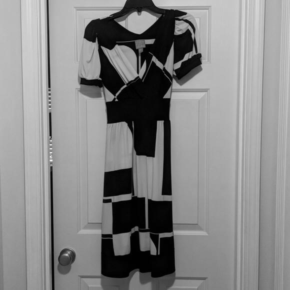 Black and cream knee length dress